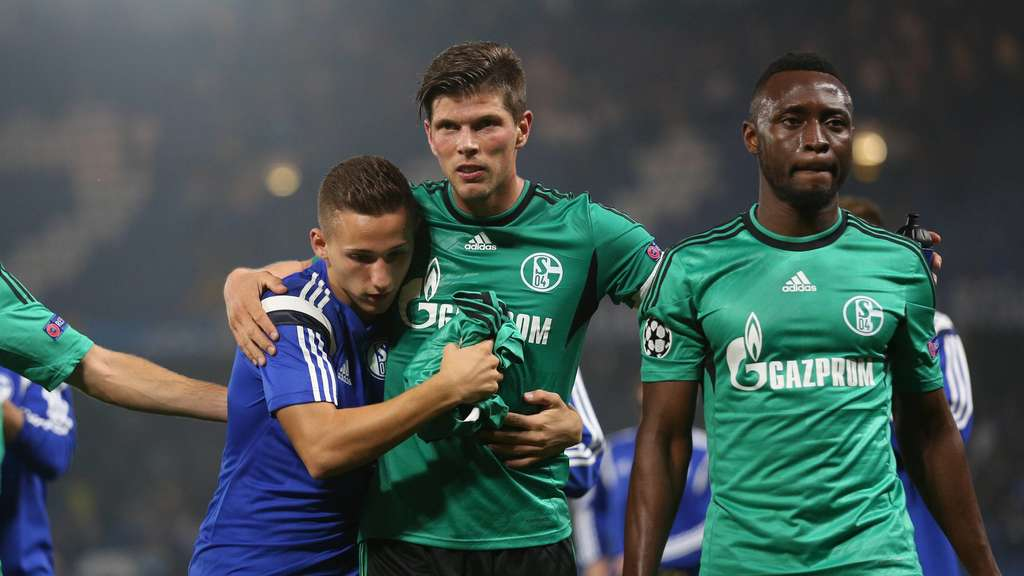 Schalke&#39s Donis Avdijaj (l), Klaas-Jan Huntelaar (c) and Chinedu Obasi celebrate the 1-1 against Chelsea after the UEFA Champions League Group G soccer match between Chelsea FC and FC Schalke 04 at Stamford Bridge stadium in London, Britain, 17 September 2014. Photo: Ina Fassbender/dpa +++(c) dpa - Bildfunk+++