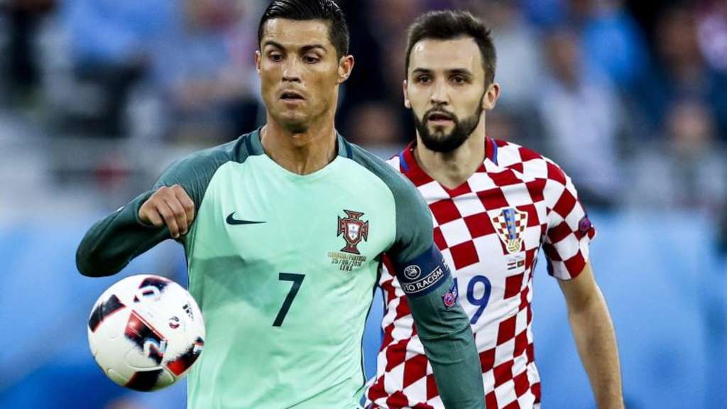 Cristiano Ronaldo im Duell mit Kroatiens Milan Badelj. Foto: Miguel A. Lopes
