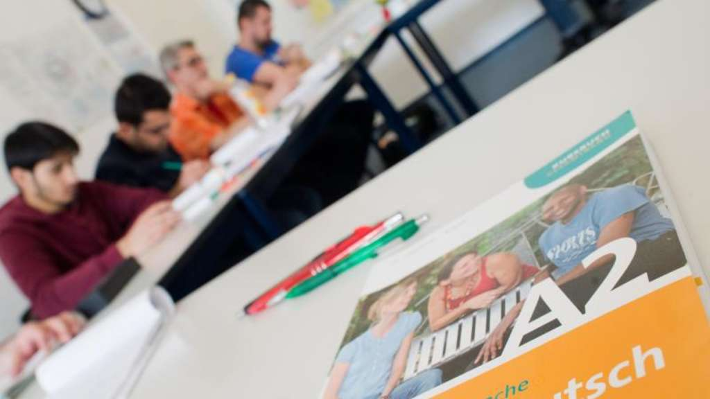 Integrationskurs (BAMF-Kurs). Foto: Julian Stratenschulte/Illustration