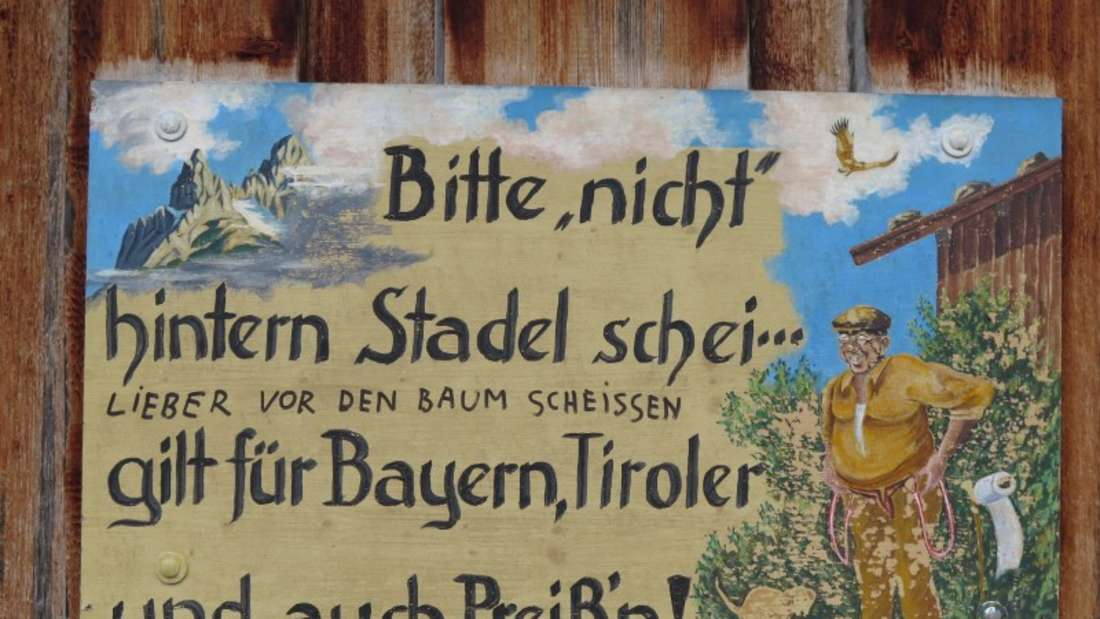 Schild an einer Hütte in Mittenwald.
